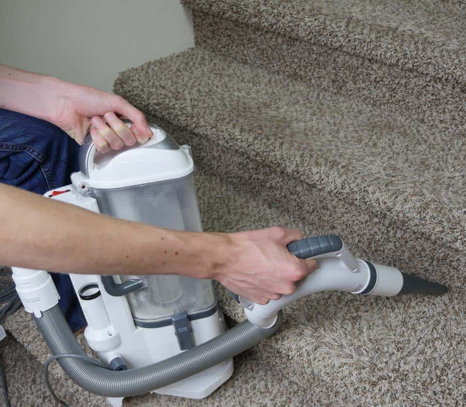 Shark Navigator Pro vacuuming stairs in canister mode