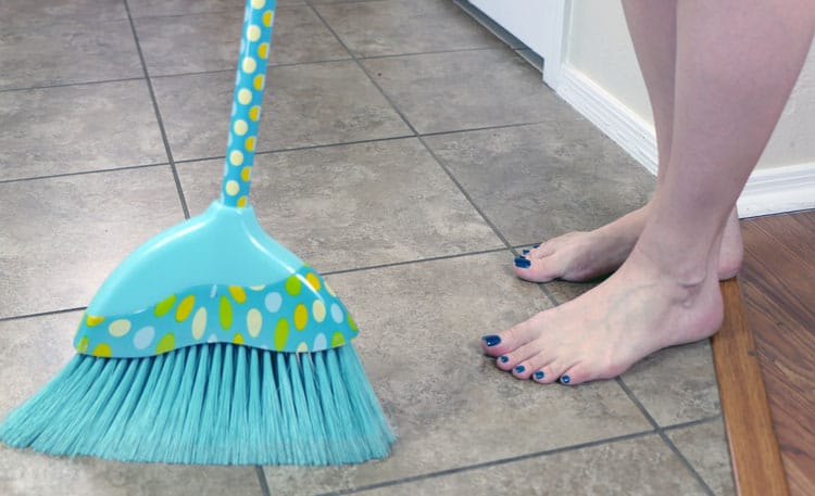 Sweep your floor before applying grout cleaner