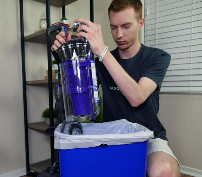 Emptying the dust bin on the Dyson Animal 2 upright