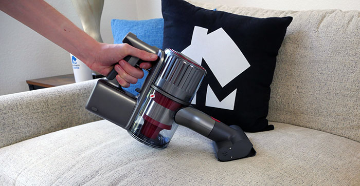 Cleaning the couch with the Roborock H6 vac